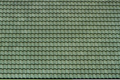 Old green tile roof (pattern texture). Old green tile roof in Thailand (pattern texture Stock Photo