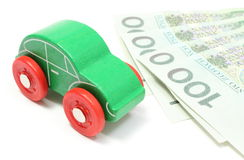 Old green toy car with money on white background Royalty Free Stock Photos