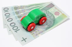Old green toy car with money on white background Stock Images