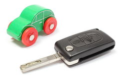 Old green toy car and vehicle key on white background Royalty Free Stock Image