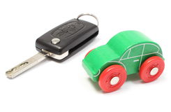Old green toy car and vehicle key on white background Stock Image