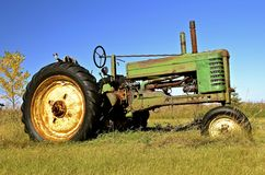 Old green tractor Stock Photos