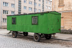 Old green trailer on a road Stock Photography