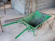 Old green trolley. Old green trolley for contain the cement brick to built in the unfinished house Royalty Free Stock Photos