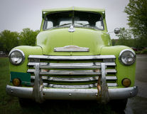 Old Green Truck. Vintage green pickup truck with chrome grill stock images