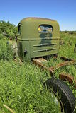 An old green truck in long grass Royalty Free Stock Images