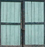 Old green turquoise coloured wood door Stock Image