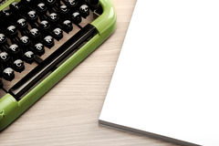 Old green typewriter on the office desk Stock Image