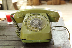 Old green vintage telephone Stock Photo
