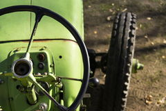 Old green vintage tractor stands on farm yard Royalty Free Stock Photos