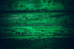 Old green vintage wood. Dark green vintage wood texture and background. Abstract texture and background for designers. Old vintage. Wood paint in dark green Stock Photos