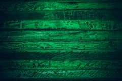 Old green vintage wood. Dark green vintage wood texture and background. Abstract texture and background for designers. Old vintage. Wood paint in dark green Stock Images