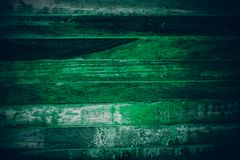 Old green vintage wood. Dark green vintage wood texture and background. Abstract texture and background for designers. Old vintage. Wood paint in dark green Royalty Free Stock Images