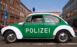 Green VW beetle police car royalty free stock photography