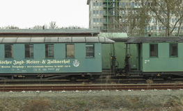 Old green wagons parked at the station Royalty Free Stock Photo