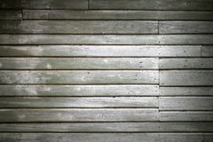 Old green wall made of wooden lining boards stock image