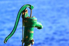 Old, Green Water Pump Handle Stock Image