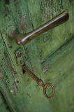Old green weathered door handle and lock. Stock Image