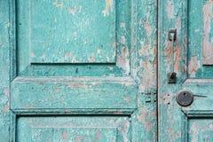 Old green weathered door Stock Photo