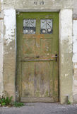 Old, green, weathered wooden door Royalty Free Stock Images