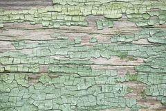 Old green weathered wooden wall with paint Stock Photo