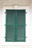 Old green window with closed shutters Royalty Free Stock Photo