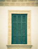 Old green window with closed shutters Royalty Free Stock Image