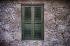 Old green window with closed shutters Stock Images