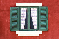 Old Green Window with Curtain on Red Wall. Retro Royalty Free Stock Image