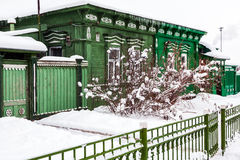 Old green wodden house in cloudy winter day in ancient Russian town Royalty Free Stock Image