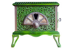 Old Green Wood Burner. Old indoor wood burner with a decorative pattern scratches and dents from use on an  white background with a clipping path Royalty Free Stock Photos