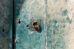 Green door with knocker Royalty Free Stock Image