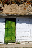 Old green wooden door. Old wooden house with a green door Royalty Free Stock Images