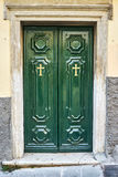 Old green wooden door of orthodox Church Royalty Free Stock Photos