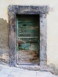 Old green wooden door Stock Photos