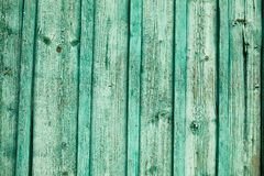 Old green wooden fence background. Texture close up Royalty Free Stock Image