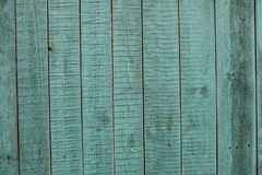 Old green wooden fence background. Texture close up Stock Photos