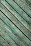 Old green wooden fence background. Texture close up Stock Image