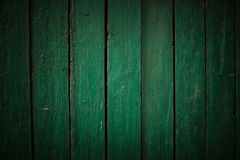 Old green wooden fence background. Texture close up Stock Images