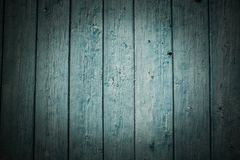 Old green wooden fence background. Texture close up Royalty Free Stock Images
