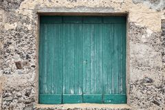 Old green wooden gate in stone wall Royalty Free Stock Images