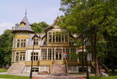 Old green wooden house in skansen in Lodz, Poland - Central Museum of Te Stock Photography