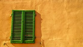 Old, green shutters in Florence, Italy royalty free stock images