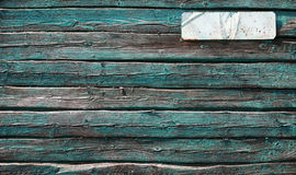 Old green wooden wall with white label Royalty Free Stock Photo