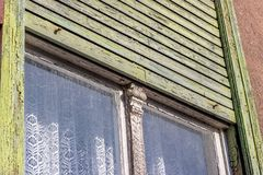 Old, green, wooden window. Detail of a old, wooden window with green Roller blind Stock Photos