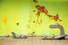 Old green and yellow metal wall Stock Images