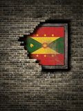 Old Grenada flag in brick wall Stock Images