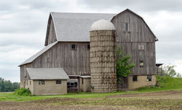 Old Grey barn  and silo Royalty Free Stock Image