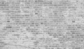 Old grey brick wall. Old white gray brick wall with peeling white paint with copie space for your text and images Royalty Free Stock Photography