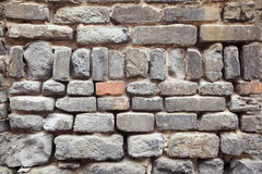 Old grey bricks wall closeup Royalty Free Stock Image